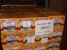 Donated pancake mix ready for distribution.