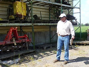 Tom Sweeney surveying equipment inventory prior  to planting time at Country Heritage Farms.